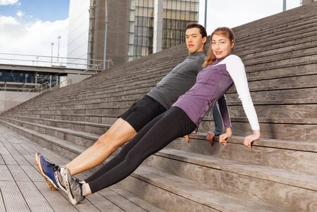 reverse: Active young people doing reverse plank exercises