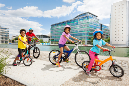 African children enjoying cycling together in town