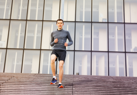 Active man training outdoors on city stairs
