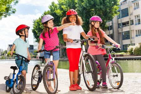 Little cyclists with their bicycles on cycle path