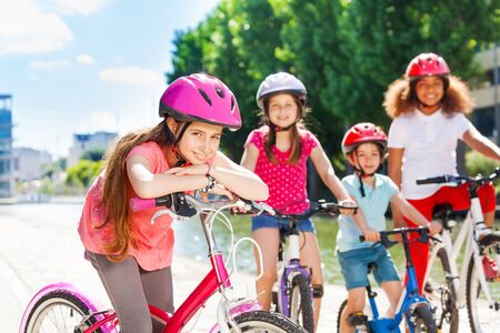 Girl standing with bicycle and waiting for friends Stock Photo