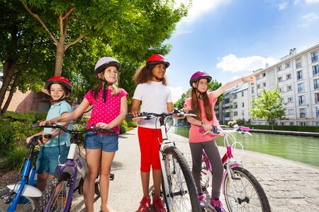 Children with bicycles searching right way