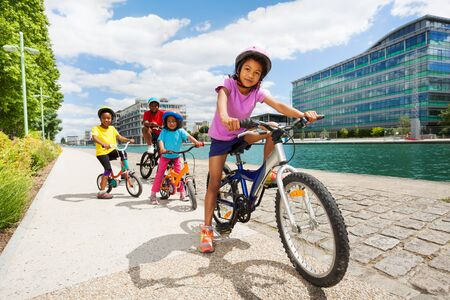 African children riding bikes one after another