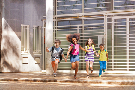 Group of happy run after school