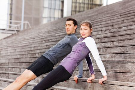 reverse: Sporty young couple holding reverse plank position