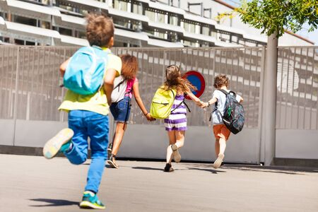 Group of kids run to school one after another
