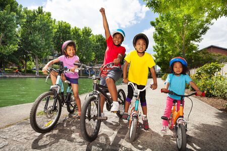 Little bicycle riders enjoying cycling outdoors