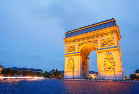 Illuminated Arc de Triomphe at the top of the Champs-elysees, Paris, France 스톡 콘텐츠