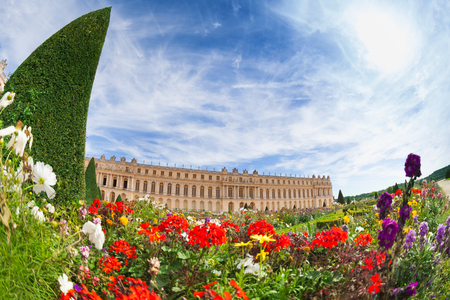 Scenic view of flowery gardens in front of the Palace of Versailles at sunny day, France Stock Photo