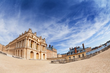 Fish-eye picture of the Palace of Versailles against cloudy sky, France 版權商用圖片