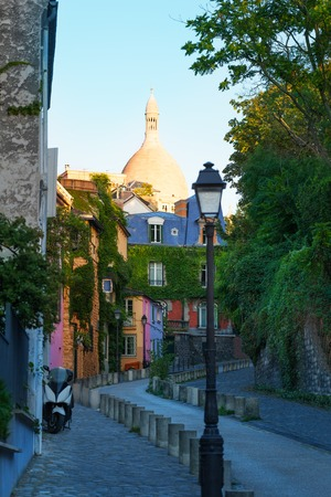 Narrow street of Paris with beautiful color houses
