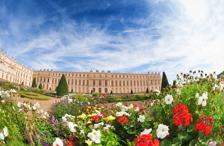Palace of Versailles against the flowery gardens Stock Photo