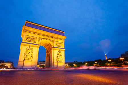 Illuminated Arc de Triomphe at night, Paris