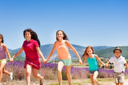 Excited children running together in Provence