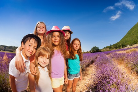 Portrait of happy kids standing in lavender field Stock Photo