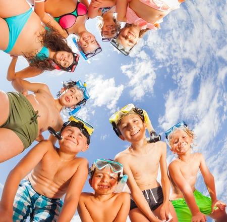 Big group of kids having fun on the beach