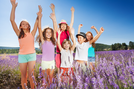Happy kids having fun outdoors in lavender field Stock Photo