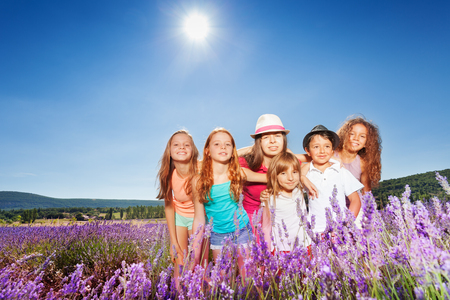 Kids hugging in lavender field at summers day