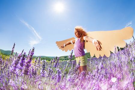 Little dreamer preparing to fly like a bird