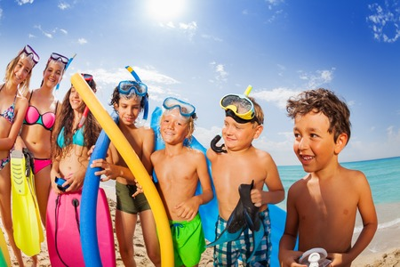 Kids group vacation portrait on a beach