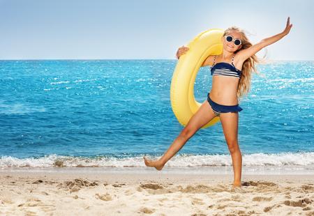 Girl having fun on beach during summer vacation