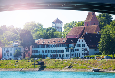 Waterfront view of Basel under bridge across Rhine