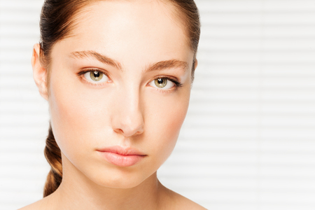 Attractive dark-haired woman with clean skin face