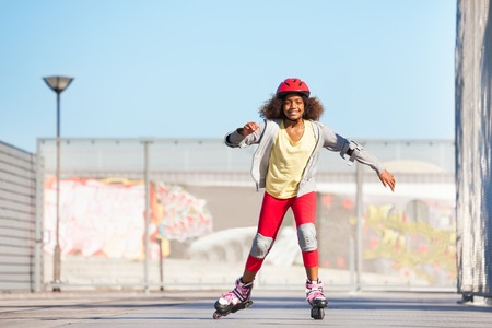 African girl exercising at outdoor rollerdrom