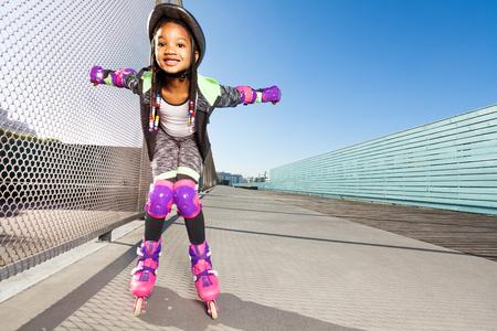 Girl in roller blades doing tricks at skate park