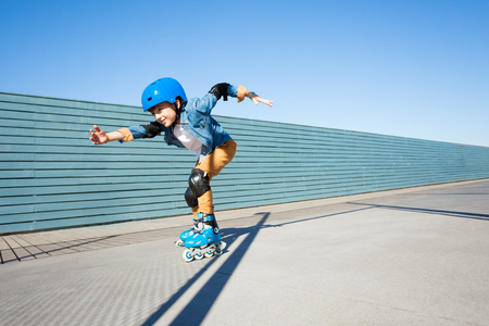 Young roller skater riding fast at rollerdrom