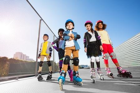 Happy multiethnic kids in rollerskates outdoors