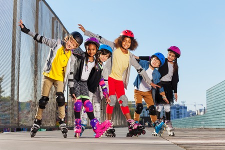 Happy sporty inline skaters having fun outdoors