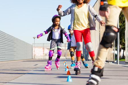 Kids learning to slalom skate with inline skates 写真素材