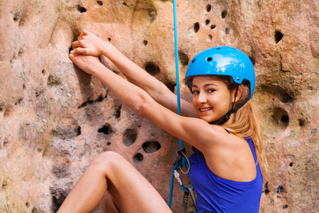 Female rock climber in helmet exercising outdoors Stok Fotoğraf