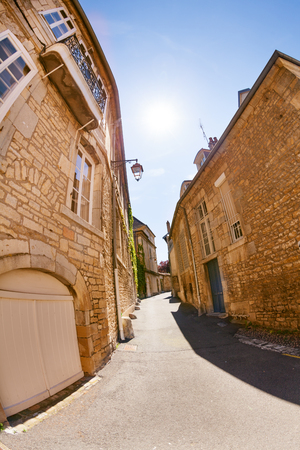 Narrow street of old city in Besancon at sunny day Stock Photo - 95921490