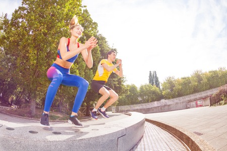 Athletes performing jumps during functional train