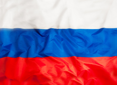 Russia national flag with waving fabric