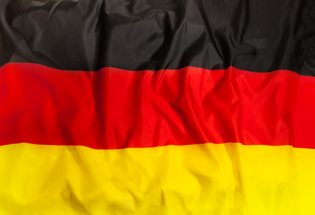 Germany national flag with waving fabric 스톡 콘텐츠