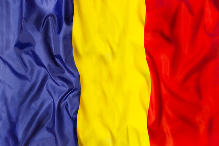 Romania national flag with waving fabric Imagens - 101292015