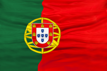 Portugal national flag with waving fabric Фото со стока