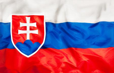 Bandera nacional de Eslovaquia con tela ondeante Foto de archivo