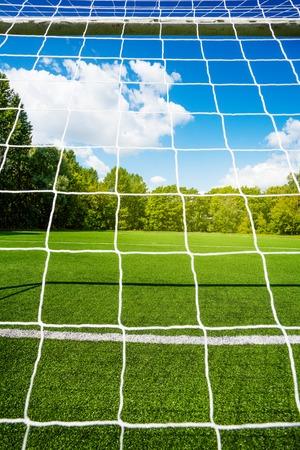 Soccer net and football stadium empty field