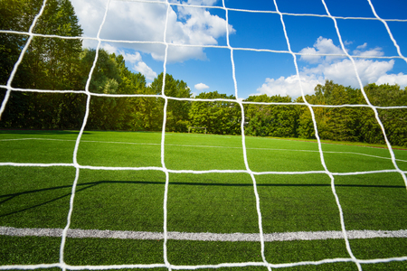 Gate net and small empty soccer stadium Stock Photo