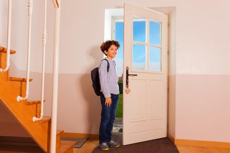Preteen boy coming back home from school Archivio Fotografico