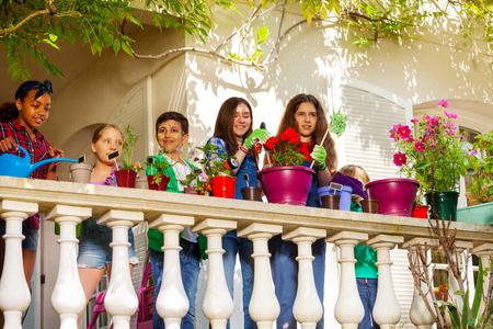 Happy multiethnic children making terrace garden 免版税图像