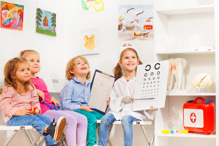 Little oculist and patients at the doctors room