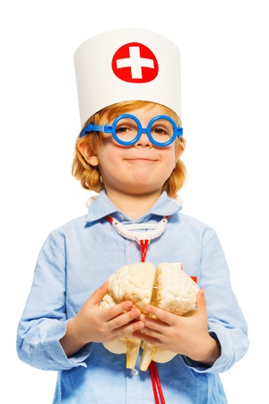 Young boy with medical cap and cerebrum dummy