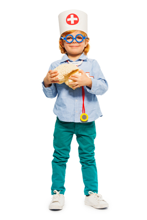 Young doctor in toy glasses with cerebrum dummy Banco de Imagens - 106106765