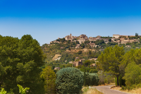 Gordes town view from the road, commune in the Vaucluse department in the Provence-Alpes-Cote dAzur region in southeastern France