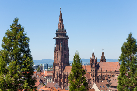 Freiburg cathedral tower against blue sky, Germany, Europe Stock Photo